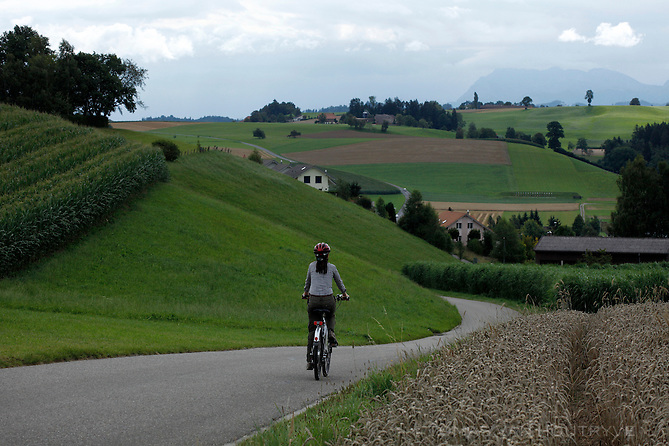 A cyclist rides a Flyer e-bike on the Herzroute between Madiswil and Willisau, Emmantal, Switzerland on Aug. 9, 2011.