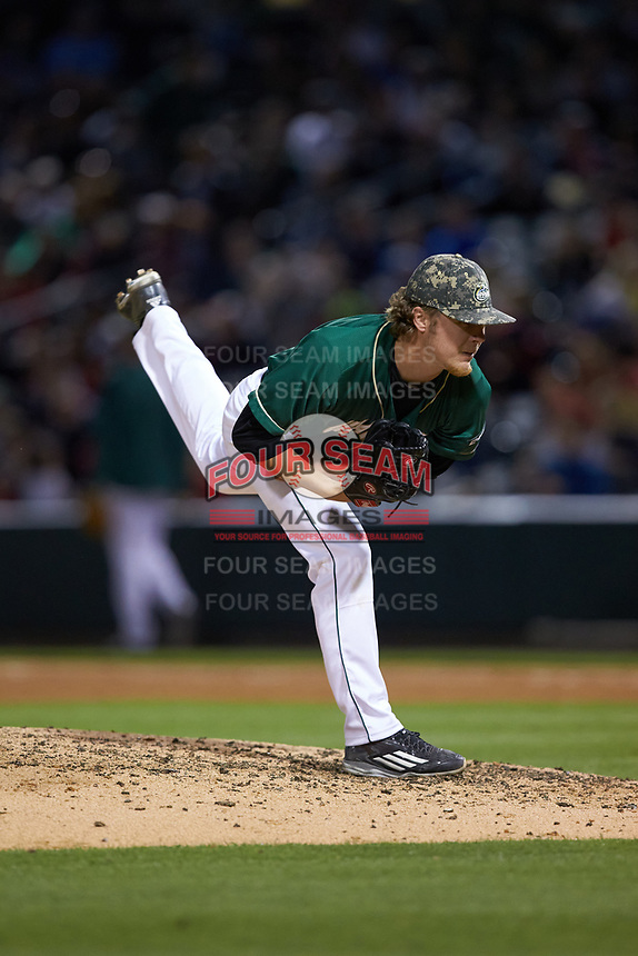Charlotte 49ers relief pitcher Holden Capps (6) follows through on his delivery against the North Carolina State Wolfpack at BB&T Ballpark on March 29, 2016 in Charlotte, North Carolina. The Wolfpack defeated the 49ers 7-1.  (Brian Westerholt/Four Seam Images)