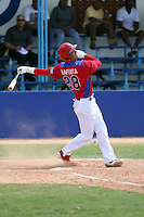 Leonardo Lafitta works out at the Dominican Republic air force base in front of 100+ Major League Baseball scouts prior to being declared eligible to sign since defecting from his native Cuba in Santo Domingo, Dominican Republic on February 11, 2015 (Bill Mitchell)