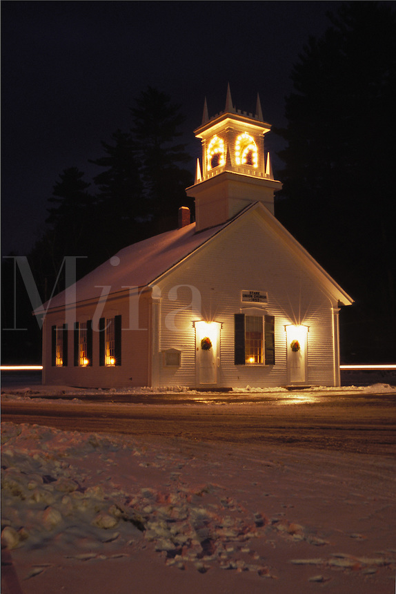 New England church on winter night