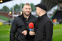 Joe Marler of Harlequins chats with Matt Dawson as he takes on the BT Sport presenter role for the match