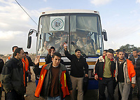 "Palestinians shout in front of a bus as they ask to leave Gaza at the Erez crossing December 2, 2007. About 250 Palestinians left Gaza through the northern Erez crossing on their way to Egypt after the Israeli authorities granted permission to those holding residence permits in Egypt and other foreign countries. ""photo by Fady Adwan"""