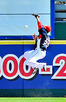 8 March 2010: Washington Nationals' outfielder Willie Harris makes an attempt to catch a fly ball home run during a Spring Training game against the Florida Marlins at Space Coast Stadium in Viera, Florida. The Marlins defeated the Nationals 12-2 in Grapefruit League action. Mandatory Credit: Ed Wolfstein Photo