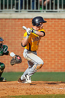 Ronnie Bernick (2) of the Canisius Golden Griffins follows through on his swing against the Charlotte 49ers at Hayes Stadium on February 23, 2014 in Charlotte, North Carolina.  The Golden Griffins defeated the 49ers 10-1.  (Brian Westerholt/Four Seam Images)