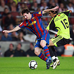 Football Season 2009-2010. Barcelona's player Lionel Messi (L) is challanged against Zaragoza's Abel Aguilar (R) during their Spanish first division soccer match at Camp Nou stadium in Barcelona October 25, 2009