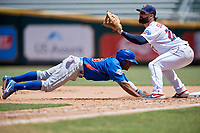 Tennessee Smokies Roberto Caro (25) dives back to the bag as first baseman John Silviano (22) waits for a pickoff attempt throw during a Southern League game against the Jacksonville Jumbo Shrimp on April 29, 2019 at Baseball Grounds of Jacksonville in Jacksonville, Florida.  Tennessee defeated Jacksonville 4-1.  (Mike Janes/Four Seam Images)