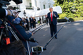 United States President Donald J. Trump speaks to the media on the South Lawn of the White House in Washington, DC before departing to attend a political event in Fayetteville, North Carolina on Saturday, September 19, 2020.<br /> Credit: Chris Kleponis / Pool via CNP