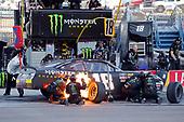 #18: Riley Herbst, Joe Gibbs Racing, Toyota Supra Monster Energy pit stop