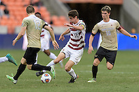 Houston, TX - Friday December 11, 2016: Drew Skundrich (12) of the Stanford Cardinal attempts to dribble the ball around Brad Dunwell (12) of the Wake Forest Demon Deacons at the NCAA Men's Soccer Finals at BBVA Compass Stadium in Houston Texas.