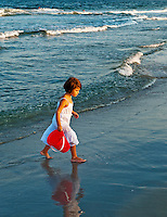 Girl plying in ocean.