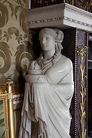 Detail of a marble figure on the drawing room fire surround designed by James Byres. Delicately carved and gilded  grasses  decorate the front panels of the fireplace