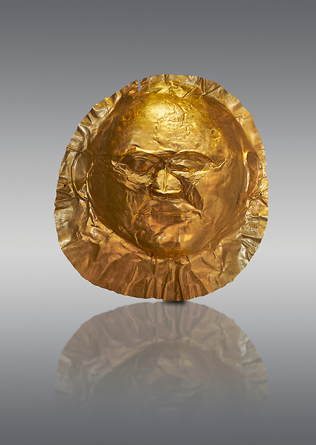 Mycenaean gold death mask, Grave Cicle A, Mycenae, Greece. National Archaeological Museum of Athens.  Grey Background<br /> <br /> <br /> This death mask is typical of the other Mycenaean gold death masks fround in Grave V except in this mask the eyes are open. made from a sigle sheet of gold the shape of the face would have been hammered ot against wood. two holes either side of the gold mask allowed it to be held over the dead mans face. As weapons were found in the graves of Grave Circle A at Mycenae, those buried here wer warriors and maybe kings as the grave goods buried with them were of great value. 16th century BC