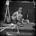 An elder Balinese man works in a rock quarry. Average wages are about $1 US a day. Indonesia has more than 210 million citizens and more than 40 million people are unemployed.