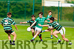 St Kierans Cathal Brosnan gets his effort away despite the attempted block down by Oisin Maunsell of St Brendans in the County Minor Football Championship.