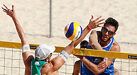 Italy's Paolo Nicolai and Austria's Robin Seidl, left, in action during the match between Italy and Austria at Beach Volleyball World Tour Grand Slam, Foro Italico, Rome, 21 June 2013.<br /> UPDATE IMAGES PRESS/Isabella Bonotto
