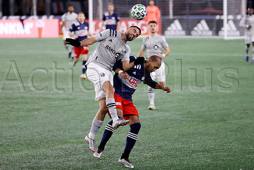 20th November 2020; Foxborough, MA, USA;  Montreal Impact defender Rudy Camacho wins the header from New England Revolution midfielder Teal Bunbury during the MLS Cup Play-In game between the New England Revolution and the Montreal Impact
