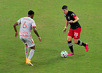 WASHINGTON, DC - SEPTEMBER 12: Joseph Mora #28 of D.C. United dribbles during a game between New York Red Bulls and D.C. United at Audi Field on September 12, 2020 in Washington, DC.