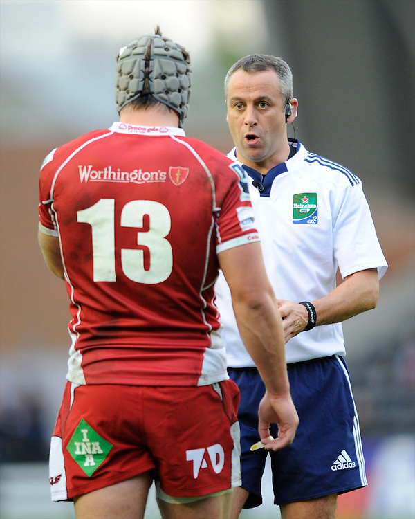 Referee John Lacey of Ireland talks to Jonathan Davies of Scarlets during the Heineken Cup Round 1 match between Harlequins and Scarlets at the Twickenham Stoop on Saturday 12th October 2013 (Photo by Rob Munro)