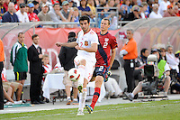 Raul Albiol (2) of Spain passes the ball as Jonathan Spector (2) of the United States trails. The men's national team of Spain (ESP) defeated the United States (USA) 4-0 during a International friendly at Gillette Stadium in Foxborough, MA, on June 04, 2011.