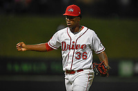 Relief pitcher Joan Martinez (36) of the Greenville Drive shouts and pumps his fist after completing a scorless inning in Game 3 of the South Atlantic League Southern Division Playoff against the Charleston RiverDogs on Saturday, September 9, 2017, at Fluor Field at the West End in Greenville, South Carolina. Greenville won, 5-0, winning the division championship two games to one. (Tom Priddy/Four Seam Images)