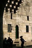 People in the shadows at Eminonu, Istanbul, Turkey