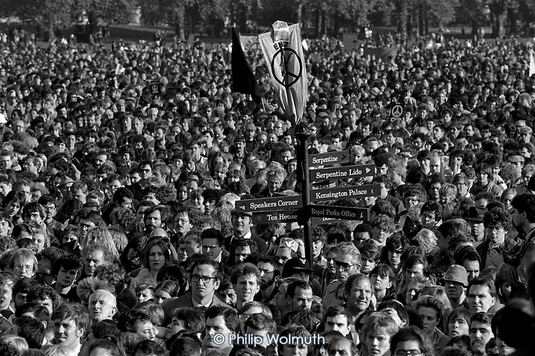 A mass CND rally surrounds a signpost to Speakers Corner in Hyde Park, London,