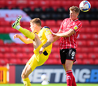 Oxford United's Josh Ruffels clears under pressure from Lincoln City's James Jones<br /> <br /> Photographer Andrew Vaughan/CameraSport<br /> <br /> The EFL Sky Bet League One - Saturday 12th September  2020 - Lincoln City v Oxford United - LNER Stadium - Lincoln<br /> <br /> World Copyright © 2020 CameraSport. All rights reserved. 43 Linden Ave. Countesthorpe. Leicester. England. LE8 5PG - Tel: +44 (0) 116 277 4147 - admin@camerasport.com - www.camerasport.com - Lincoln City v Oxford United