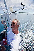 Self-portrait of professional photographer Tor Johnson taken at the top of yacht mast