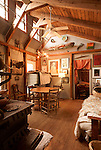 January 2, 2013. Pittsboro, North Carolina. . Ms. Scarpa's home is heated by a huge wood stove and has many of the structural elements exposed for the 40 or so cats that live in the house to play on.. Siglinda Scarpa, originally from northern Italy, runs the Goathouse Refuge, a no kill shelter for cats. Scarpa, who is also a ceramic artist, runs the shelter with 5 full time employees and currently has over 260 cats in the refuge..