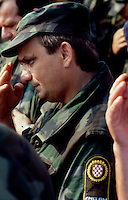Osijek / Croazia 1991.Branimir Glavas, commander of the croat army in Osijek during the war in 1991-92..Photographed during the funeral of one croat soldier fighting in the 'International Brigade'..In 2005/2006, Glava was accused of war crimes, guilty of torture and murder of Serb civilians in Osijek during the war, and was sentenced to 10 years in prison..Photo Livio Senigalliesi