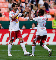 Juan Pablo Angel (9) of the New York Red Bulls celebrates a goal with teammate Dane Richards (19) at RFK Stadium in Washington, DC.  The New York Red Bulls defeated D.C. United, 2-0.
