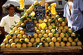 Rio de Janeiro, Brazil. Street market stall selling oranges in a pyramid pile 'boa para suco' (good for juice).