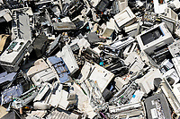 GERMANY, Hamburg, recycling of electronical scrap and old consumer goods at company TCMG, the trash is collected by the urban waste disposal system and than processed and separated here after metals like copper and plastics for further recycling and reuse, by law is not allowed to export e-scrap to africa and other countries, printer and copy machines