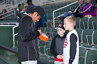 Bernardo Flores (32) of the Kannapolis Intimidators signs a cap for a young fan prior to the game against the Asheville Tourists at Kannapolis Intimidators Stadium on May 6, 2017 in Kannapolis, North Carolina.  The Intimidators walked-off the Tourists 7-6.  (Brian Westerholt/Four Seam Images)