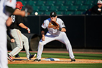 Jackson Generals first baseman Kevin Cron (50) waits to receive a throw as Ryan Walker (18) retreats to first base during a game against the Chattanooga Lookouts on April 27, 2017 at The Ballpark at Jackson in Jackson, Tennessee.  Chattanooga defeated Jackson 5-4.  (Mike Janes/Four Seam Images)