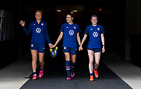 HOUSTON, TX - JUNE 9: Lindsey Horan #9, Abby Dahlkemper #7 and Rose Lavelle #16 of the USWNT walk onto the field before a training session at BBVA Stadium on June 9, 2021 in Houston, Texas.
