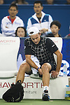 SHANGHAI, CHINA - OCTOBER 13:  Andy Rodick of the United States examines his knee before retiring from his match against Stanilas Wawrinka of Switzerland during day three of 2009 Shanghai ATP Masters 1000 at the Qi Zhong Tennis Centre in Shanghai. Photo by Victor Fraile / The Power of Sport Images