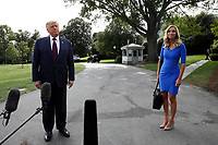 United States President Donald J. Trump with White House Press Secretary Kayleigh McEnany speaks with reporters on the South Lawn of the White House in Washington before his departure to Philadelphia on September 15, 2020. <br /> Credit: Yuri Gripas / Pool via CNP /MediaPunch