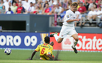 Robbie Rogers (7) gets past the slide tackle of Marc Marshall (6). USA defeated Grenada 4-0 during the First Round of the 2009 CONCACAF Gold Cup at Qwest Field in Seattle, Washington on July 4, 2009.