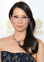 HOLLYWOOD, LOS ANGELES, CA, USA - JUNE 01: Actress Lucy Liu wearing a Carolina Herrera dress arrives at the 12th Annual Huading Film Awards held at the Montalban Theatre on June 1, 2014 in Hollywood, Los Angeles, California, United States. (Photo by Xavier Collin/Celebrity Monitor)
