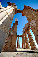 Greek Dorik columns at the  ruins of Temple F at Selinunte, Sicily Greek Dorik Temple columns of the ruins of the Temple of Hera, Temple E, Selinunte, Sicily