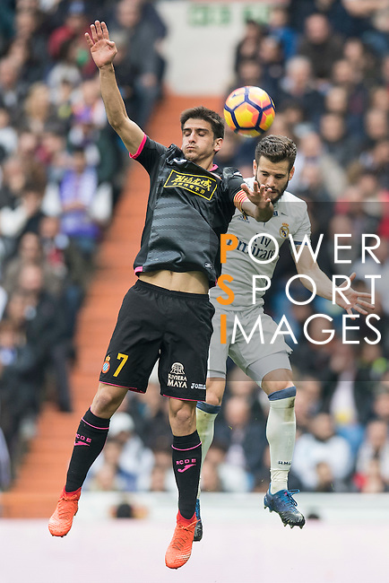 Gerard Moreno Balaguero of RCD Espanyol fights for the ball with Nacho Fernandez of Real Madrid during the match Real Madrid vs RCD Espanyol, a La Liga match at the Santiago Bernabeu Stadium on 18 February 2017 in Madrid, Spain. Photo by Diego Gonzalez Souto / Power Sport Images