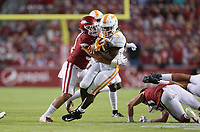 Arkansas linebacker Grant Morgan (31) tackles Tennessee running back Eric Gray (3), Saturday, November 7, 2020 during the first quarter of a football game at Donald W. Reynolds Razorback Stadium in Fayetteville. Check out nwaonline.com/201108Daily/ for today's photo gallery. <br /> (NWA Democrat-Gazette/Charlie Kaijo)