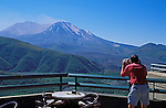 Man viewing crater of Mount Saint Helens volcano from Coldwater Ridge Visitor Center, Mt. St. Helens National Volcanic Monument, Washington.  .#2428-1115   [MR]