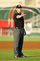 Umpire Travis Godec tells Kannapolis Intimidators manager Tommy Thompson (not picture) to stop complaining about a non-balk call during the South Atlantic League game between the Greensboro Grasshoppers and the Kannapolis Intimidators at CMC-Northeast Stadium on July 15, 2013 in Kannapolis, North Carolina.  The Intimidators defeated the Grasshoppers 4-0.   (Brian Westerholt/Four Seam Images)