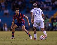 SAN PEDRO SULA, HONDURAS - SEPTEMBER 8: Antonee Robinson #5 of the United States defends Andy Najar #17 of Honduras during a game between Honduras and USMNT at Estadio Olímpico Metropolitano on September 8, 2021 in San Pedro Sula, Honduras.