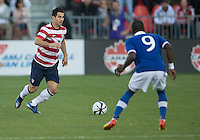 03 June 2012: US Men's National Soccer Team defender Carlos Bocanegra  #3 and Canadian Men's National Soccer Team forward Tosaint Ricketts #9 in action during an international friendly  match between the United States Men's National Soccer Team and the Canadian Men's National Soccer Team at BMO Field in Toronto..The game ended in 0-0 draw..