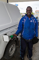 South Africa, Cape Town.  Somali Immigrant Working as Gas Station Attendant.