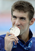 U.S. Michael Phelps kisses the gold medal after setting the new world record clocking 49.82 in the Men's 100m Butterfly final at the Swimming World Championships in Rome, 1 August 2009..UPDATE IMAGES PRESS/Riccardo De Luca