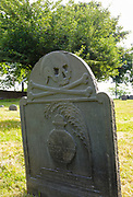 1700s headstone with skull and crossbones on it at Point of Graves Cemetery in Portsmouth, New Hampshire.